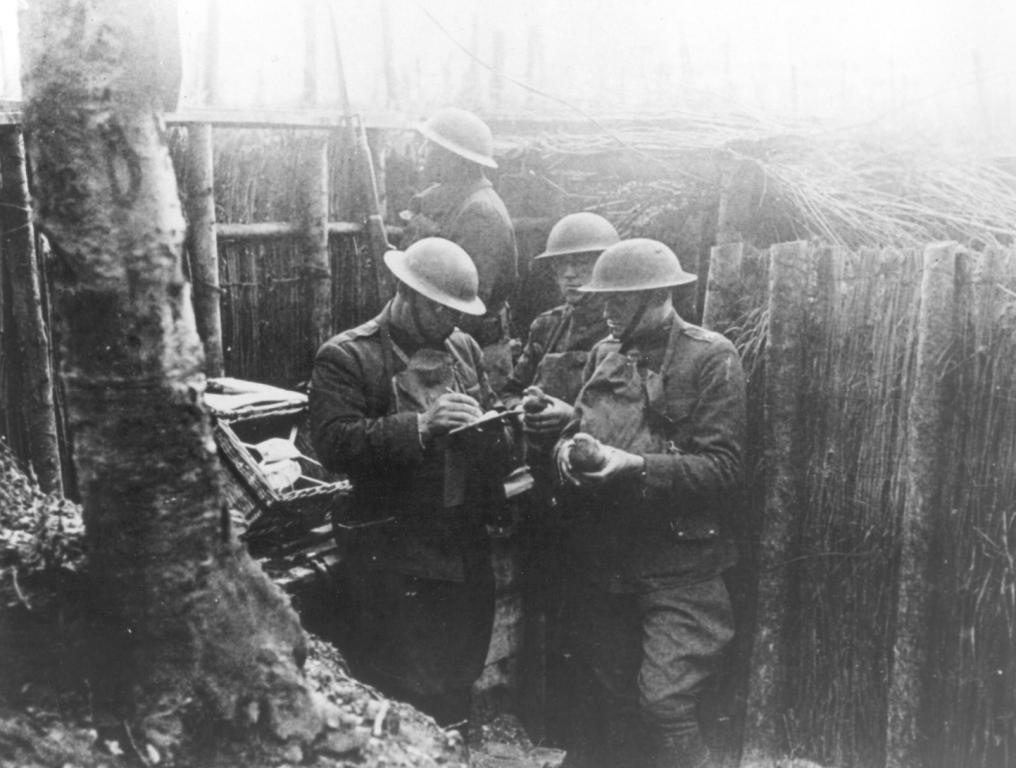US Army Reserve Soldiers writing messages in the trenches of France